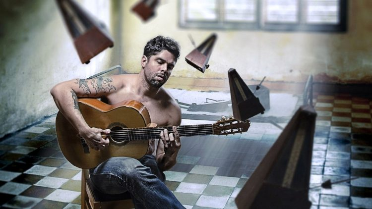 Tattooed Huy Playing Guitar